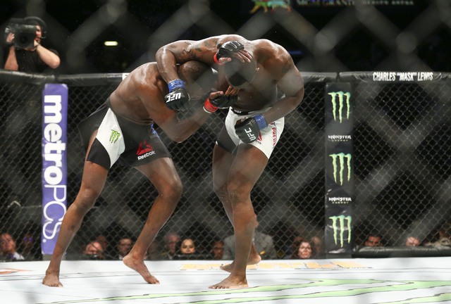 Jon Jones, left, and Ovince Saint Preux fight during an interim light heavyweight championship bout in UFC 197 at the MGM Grand Garden Arena in Las Vegas on Saturday, April 23, 2016. Jones won by  ...