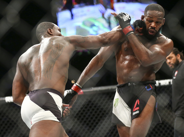 Ovince Saint Preux, left, lands a punch against Jon Jones during an interim light heavyweight championship bout in UFC 197 at the MGM Grand Garden Arena in Las Vegas on Saturday, April 23, 2016. J ...
