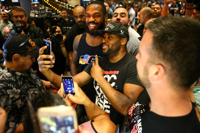 Jon Jones greet fans during open workouts ahead of UFC 197 at the MGM Grand hotel-casino in Las Vegas on Wednesday, April 20, 2016. Jones did not participate in an open workout. Chase Stevens/Las  ...