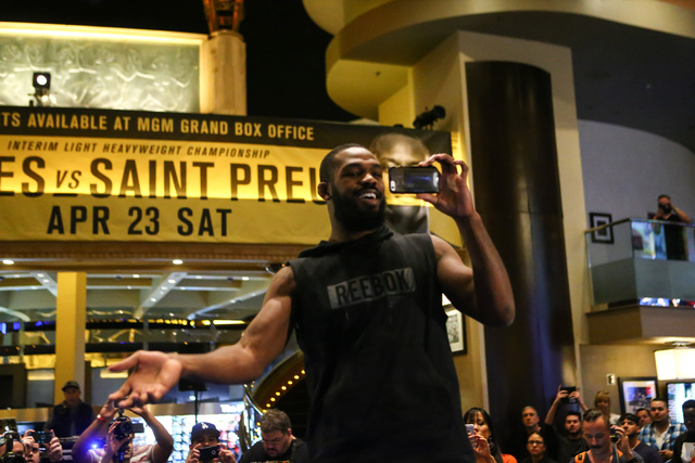 Jon Jones addresses the crowd while recording video during open workouts ahead of UFC 197 at the MGM Grand hotel-casino in Las Vegas on Wednesday, April 20, 2016. Jones did not participate in an o ...