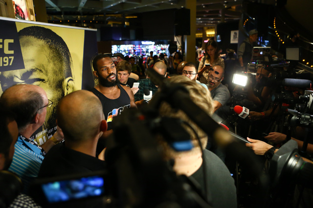 Jon Jones speaks with reporters during open workouts ahead of UFC 197 at the MGM Grand hotel-casino in Las Vegas on Wednesday, April 20, 2016. Jones did not participate in an open workout. Chase S ...