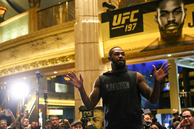 Jon Jones addresses the crowd during open workouts ahead of UFC 197 at the MGM Grand hotel-casino in Las Vegas on Wednesday, April 20, 2016. Jones did not participate in an open workout. Chase Ste ...