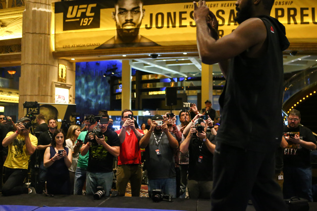 Jon Jones, right, addresses the crowd while recording video during open workouts ahead of UFC 197 at the MGM Grand hotel-casino in Las Vegas on Wednesday, April 20, 2016. Jones did not participate ...