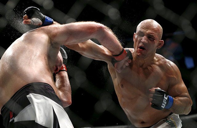 Ben Rothwell in action with Junior Dos Santos, right, in Croatia. (Antonio Bronic/Reuters)