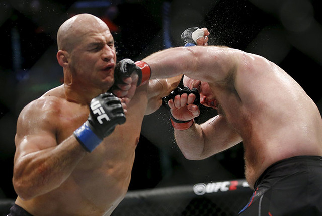 Ben Rothwell, right, in action with Junior Dos Santos in Croatia. (Antonio Bronic/Reuters)
