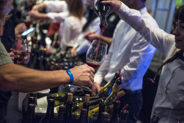Wine is poured for attendees during the UNLVino fundraiser at the Paris hotel-casino in Las Vegas on Saturday, April 16, 2016. (Joshua Dahl/Las Vegas Review-Journal)