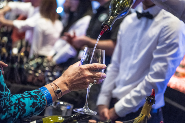 Wine is poured for attendees during the UNLVino fundraiser at the Paris hotel-casino in Las Vegas on Saturday, April 16, 2016.(Joshua Dahl/Las Vegas Review-Journal)