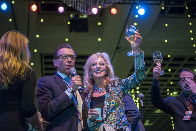 Michael Severino, general manager of Southern Wine and Spirits, left, and Jan Jones Blackhurst cheer during the UNLVino fundraiser at the Paris hotel-casino in Las Vegas on Saturday, April 16, 201 ...