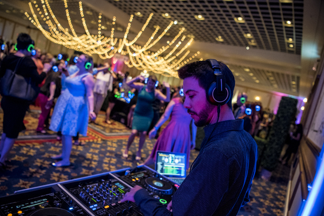 DJ Freddy B performs at the silent disco during the UNLVino fundraiser at the Paris hotel-casino in Las Vegas on Saturday, April 16, 2016. (Joshua Dahl/Las Vegas Review-Journal)