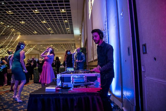 DJ Freddy B performs at the silent disco during the UNLVino fundraiser at the Paris hotel-casino in Las Vegas on Saturday, April 16, 2016. (Joshua Dahl/Las Vegas Review-Journal)