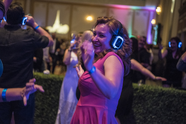 A woman dances in the silent disco during the UNLVino fundraiser at the Paris hotel-casino in Las Vegas on Saturday, April 16, 2016. (Joshua Dahl/Las Vegas Review-Journal)