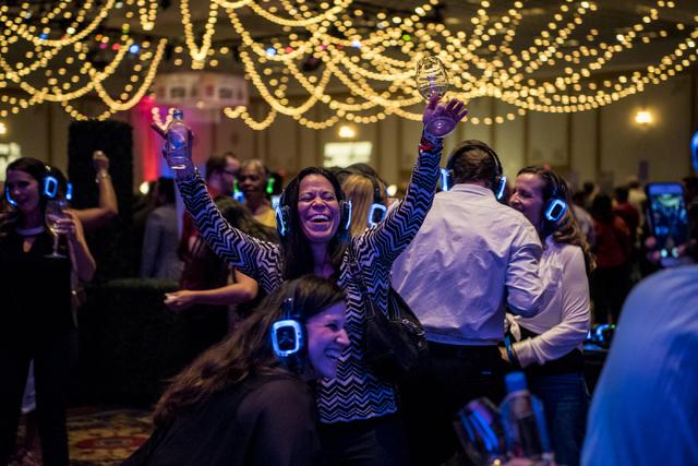 Sara Nakamura dances in the silent disco during the UNLVino fundraiser at the Paris hotel-casino in Las Vegas on Saturday, April 16, 2016. (Joshua Dahl/Las Vegas Review-Journal)