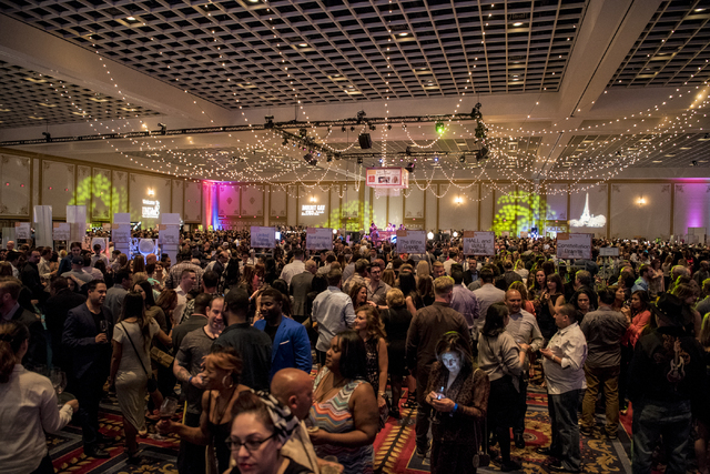 Attendees browse vender booths during the UNLVino fundraiser at the Paris hotel-casino in Las Vegas on Saturday, April 16, 2016. (Joshua Dahl/Las Vegas Review-Journal)
