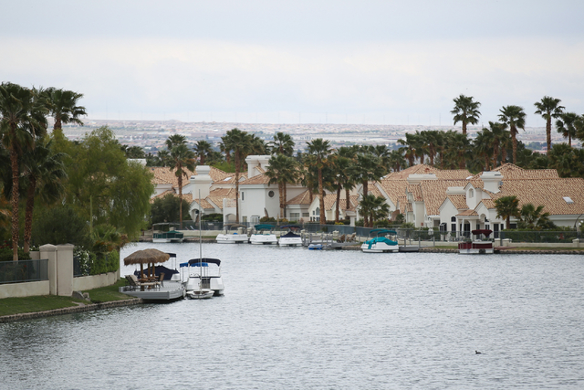 Boats are shown parked at their docks at Lake Jacqueline in Desert Shores April 8. The community's four man-made lakes make a good place to escape the hustle and bustle of Las Vegas. Visitors are  ...