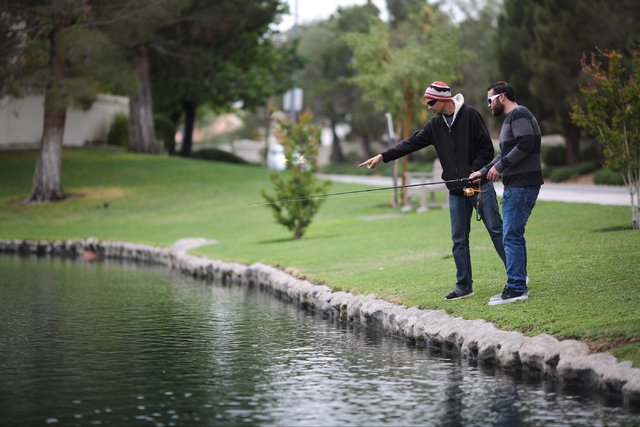 John Bryson, left, and Ray Hooper, right, test their luck at fishing in Lake Jacqueline April 10. Brett Le Blanc/View