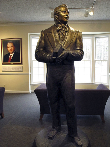 A statue of Mormonism founder Joseph Smith stands inside the visitor's center at Smith's birthplace in Sharon, Vermont. (Lisa Rathke/The Associated Press)