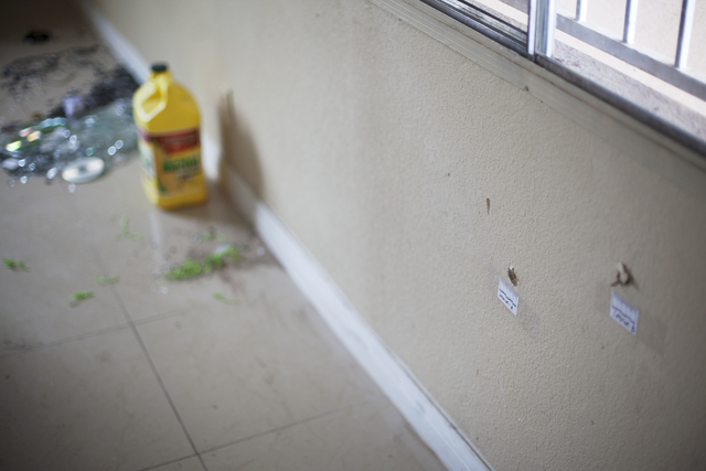 Bullet holes are seen Monday, April 25, on an inside wall of the house at the 2400 block of Page Street where a 24-year-old man was found shot to death early Sunday morning in North Las Vegas. Rac ...