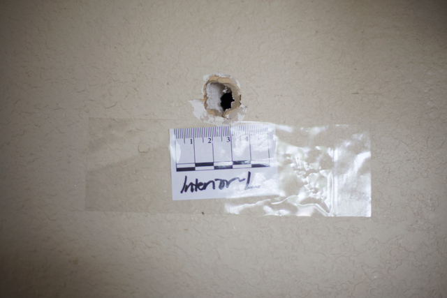 A bullet hole is seen Monday, April 25, on an inside wall of the house at the 2400 block of Page Street where a 24-year-old man was found shot to death early Sunday morning in North Las Vegas. Rac ...