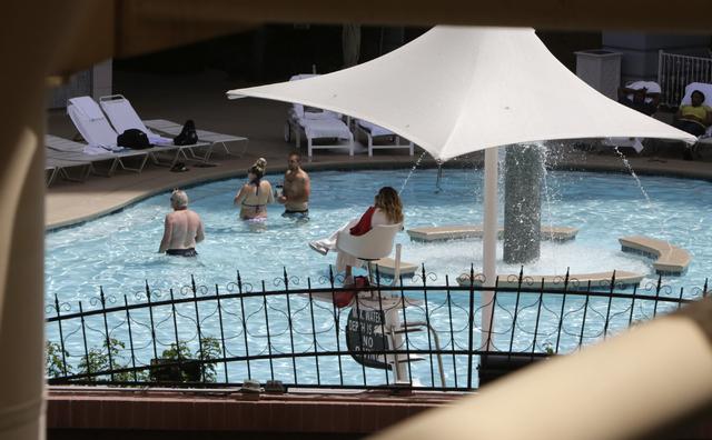 Hotel guests enjoy the outdoor swimming pool at New York-New York on the Las Vegas Strip during the warm Thursday, April 21, 2016. (Bizuayehu Tesfaye/Las Vegas Review-Journal Follow @bizutesfaye)