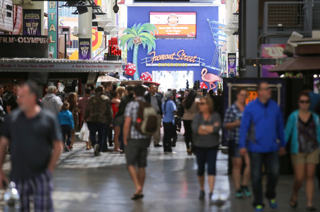 Pedestrians enjoy the warm weather under the shade of the Fremont Street Experience canopy in Las Vegas on Saturday, April 16, 2016. (Brett Le Blanc/Las Vegas Review-Journal) Follow @bleblancphoto