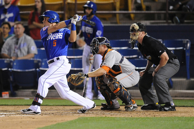 Las Vegas 51s shortstop Matt Reynolds flies out in the third inning of their minor league baseball game against the Fresno Grizzlies at Cashman Field in Las Vegas Monday April 20, 2015.(Josh Holmb ...