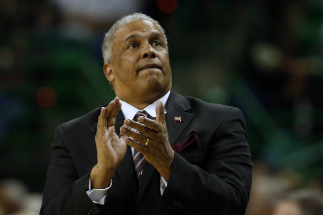 New Mexico State coach Marvin Menzies looks at the scoreboard during an NCAA college basketball game against Baylor in the second half Wednesday, Dec. 23, 2015, in Waco, Texas. (Rod Aydelotte/AP)