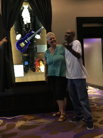 Louise Biancalana of Pahrump and Byron Lemmons of Las Vegas pose for a photo in front of a display of Prince memorabilia at the Hard Rock hotel-casino at 4455 Paradise Road in Las Vegas on Thursda ...