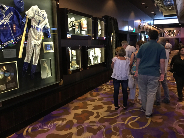 Tourists walk past a display of Prince memorabilia at the Hard Rock hotel-casino at 4455 Paradise Road in Las Vegas on Thursday, April 21, 2016. (Greg Haas/Las Vegas Review-Journal) Follow @RJgreg09