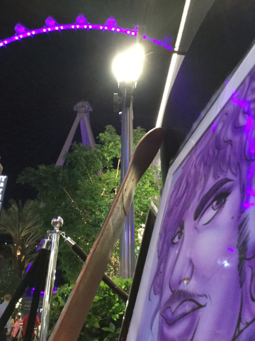 Artwork depicting Prince rests against an artist's workbench at the Linq Promenade in Las Vegas on Thursday, April 21, 2016. The High Roller was lighted purple in memory of Prince, who died Thursd ...