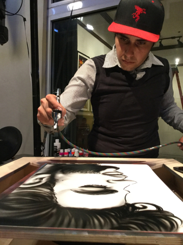 Artist Jose Colon airbrushes a portrait of Prince at the Linq Promenade in Las Vegas on Thursday, April 21, 2016. Prince died Thursday at his Minnesota home. (Greg Haas/Las Vegas Review-Journal) F ...