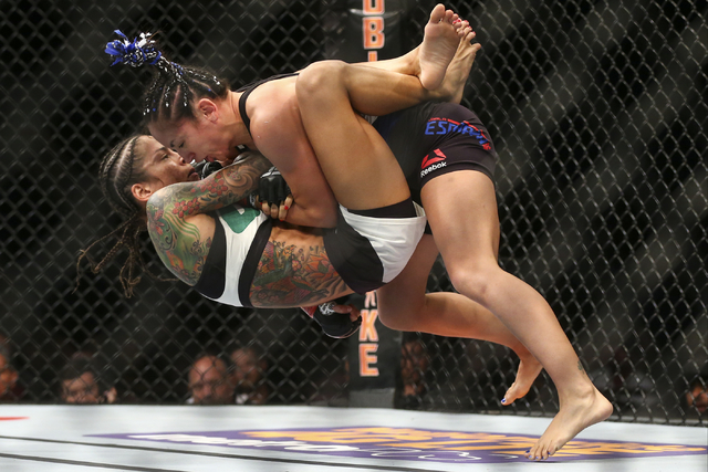 Carla Esparza, right, body slams Juliana Lima during a womenճ strawweight bout in UFC 197 at the MGM Grand Garden Arena in Las Vegas on Saturday, April 23, 2016. Chase Stevens/Las Vegas Revi ...