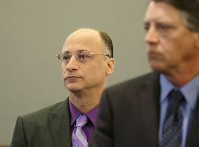 Mark Picozzi, left, stands with his attorney, Mike Schwarz, at his trial in Clark County District Court at the Regional Justice Center Wednesday, April 13, 2016, in Las Vegas. (Ronda Churchill/Las ...