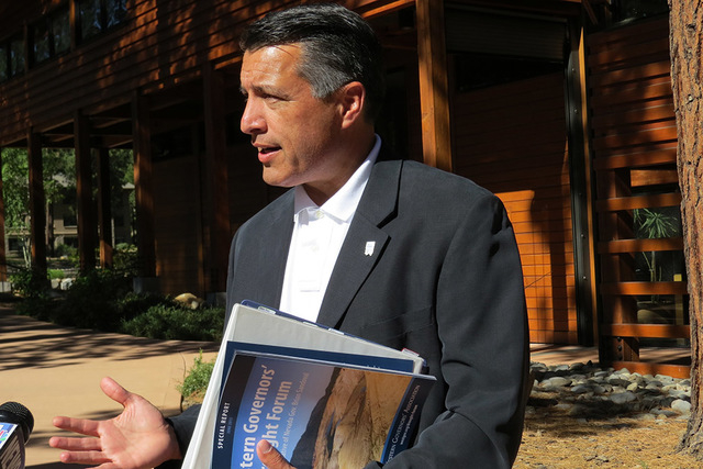 Gov. Brian Sandoval talks with reporters in Incline Village outside the Western Governors' Association drought forum Tuesday, June 23, 2015. (Sandra Chereb/Las Vegas Review-Journal)