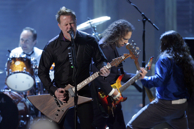 James Hetfield of Metallica performs after the band was inducted into the Rock and Roll Hall of Fame at the 2009 Rock and Roll Hall of Fame Induction Ceremony Saturday, April 4, 2009 in Cleveland. ...