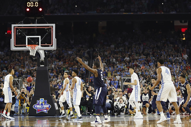 Villanova forward Kris Jenkins (2) reacts to the end of the NCAA Final Four tournament college basketball championship game against North Carolina, Monday, April 4, 2016, in Houston. Villanova won ...