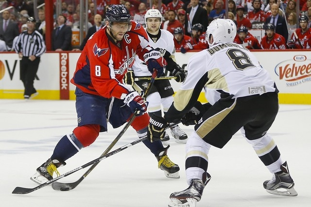 Washington Capitals left wing Alex Ovechkin (8) goes up against Pittsburgh Penguins defenseman Brian Dumoulin (8) during Game 1 of an NHL Eastern Conference semifinals Thursday, April 28, 2016, in ...