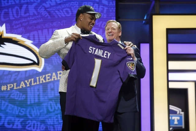 Notre Dame's Ronnie Stanley poses for photos with NFL commissioner Roger Goodell after being selected by Baltimore Ravens as the sixth pick in the first round of the 2016 NFL football draft ...