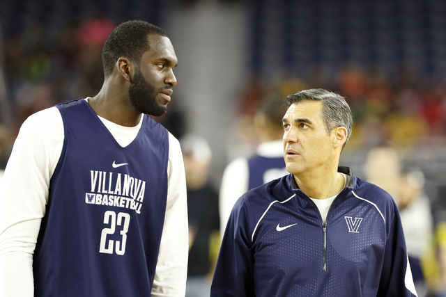 Villanova head coach Jay Wright talks to Daniel Ochefu during a practice session for the NCAA Final Four college basketball tournament Friday, April 1, 2016, in Houston. (AP Photo/Eric Gay)