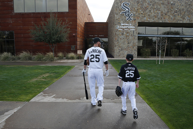 In this Feb. 28, 2015, file photo, Chicago White Sox's Adam LaRoche, left, and his son Drake walk to the White Sox's clubhouse during a photo day before a baseball spring training workout in Phoen ...