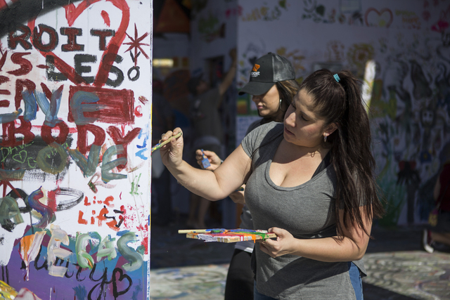 Liza Rivera paints the Life Cube Project structure at the intersection of 9th Street and Fremont Street on Friday, March 25, 2016, in Las Vegas. Erik Verduzco/Las Vegas Review-Journal Follow @Erik ...