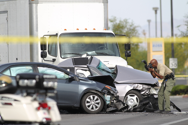 Police investigate the scene of a fatal accident on Tropical Parkway near Centennial Center Boulevard involving a box truck and two cars in Las Veags on Thursday, April 21, 2016. (Brett Le Blanc/L ...