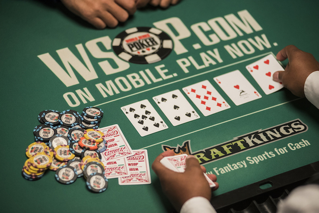 Cards are dealt during Day 3 of the $10,000 buy-in No-Limit Texas Hold 'em Championship during the World Series of Poker. (Martin S. Fuentes/Las Vegas Review-Journal)