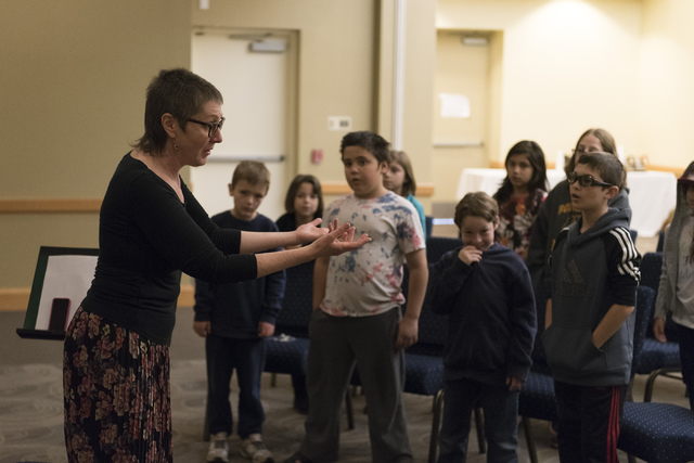 Laura Rosenberg, left, leads a group of children in a singalong of traditional Yiddish songs at Yiddish Las Vegas: A Music & Culture Festival at Temple Sinai in Las Vegas Sunday, April 10, 201 ...