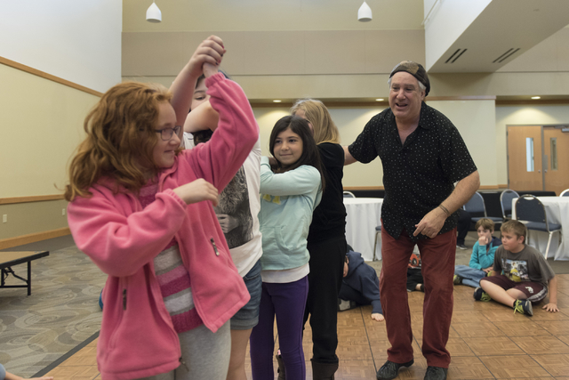 "Bruce Bierman, right, teaches children how to ""Shtok"" dance during the Moving Stories! class at Yiddish Las Vegas: A Music & Culture Festival at Temple Sinai in Las Vegas Sun ..."