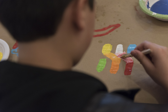 A child paints a character during a collaborative art project at Yiddish Las Vegas: A Music & Culture Festival at Temple Sinai in Las Vegas Sunday, April 10, 2016. Jason Ogulnik/Las Vegas Revi ...