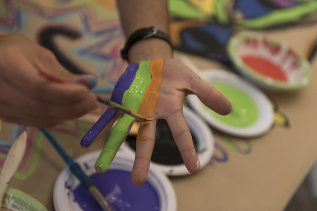 Trevor Goldsmith paints his hand during a collaborative art project at Yiddish Las Vegas: A Music & Culture Festival at Temple Sinai in Las Vegas Sunday, April 10, 2016. Jason Ogulnik/Las Vega ...