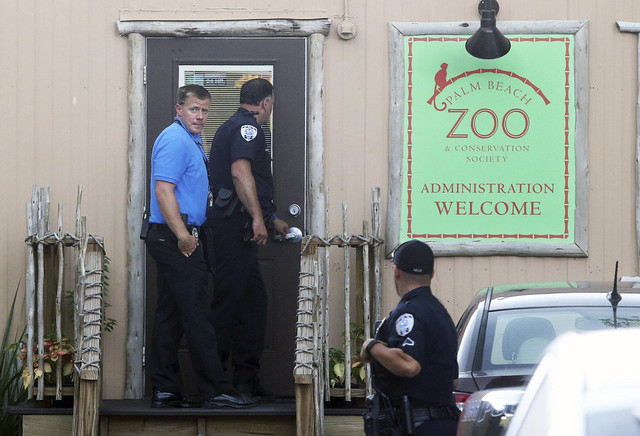 Police officers enter the administration building at the Palm Beach Zoo after zookeeper Stacey Konwiser died while being attacked by a tiger, Friday, April 15, 2016, in West Palm Beach, Fla. (Damo ...