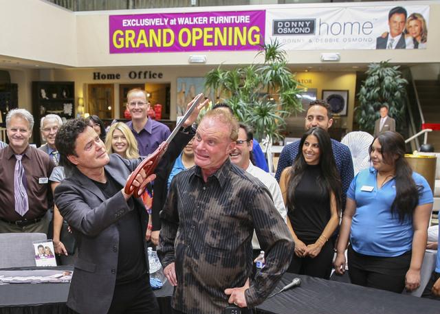 Las Vegas Headliner Donny Osmond Jokes With Larry Alterwitz, CEO Of Walker  Furniture, At