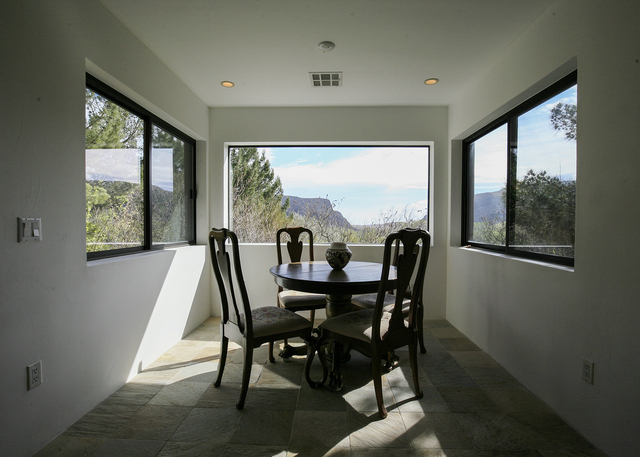 The Blue Diamond home's dining room takes in the mountain views. (ELKE COTE/MILLIONS)