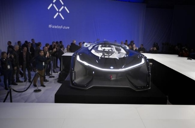 Media and guests gather around the Faraday Future FFZero1 prototype at Las Vegas Village Lot, Jan. 4, 2016. Faraday is scheduled to build a $1 billion project at APEX in North Las Vegas. (Jeff Sch ...